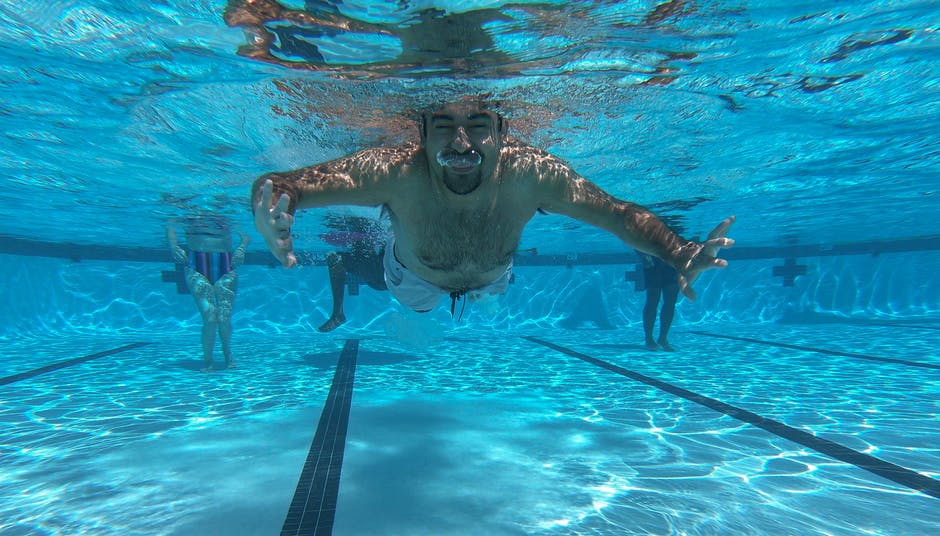 A person swimming in a pool of water